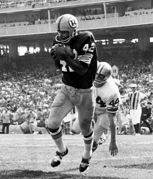 Hall of fame wide receiver Charley Taylor of the Washington Redskins catches a touchdown pass behind cornerback Dick LeBeau of the Detroit Lions .