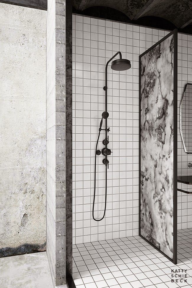 Katty Schiebeck designed this incredible apartment in Barcelona. Tiled bathroom with marble and black shower.