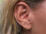 vertical tragus piercing - need!