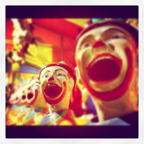 My photo of clowns in sideshow alley at a local show — put through Instagram.    See the rest of my photography portfolio on RedBubble: http://www.redbubble.com/people/felinemind