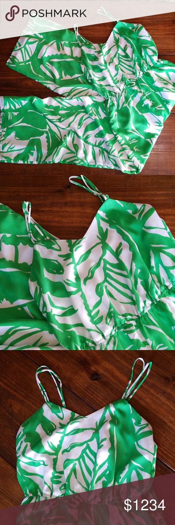 Lilly Pulitzer   For Target Boom Boom Jumpsuit Lilly Pulitzer, Lilly for Target green and white Boom Boom jumpsuit in white and green. Gorgeous and comfortable! In excellent used condition.  100% Polyester Elastic waist with front pockets. Machine washable. Sweetheart neckline. Back zip closure, white zip pull is exposed. Gold tone hardware on adjustable straps and hook and eye closure. Belt and accessories seen in stock photo are not included. Please see photos #2-8 for actual item. Lilly…