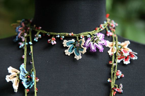 another flower oya wrap necklace, beaded. this one's crocheted, you can pick apart the flowers by studying the photo