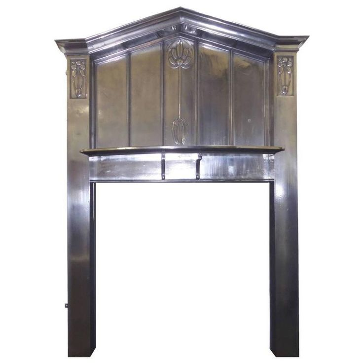Antique Early 20th Century Arts and Craft Burnished Cast Iron Surround   From a unique collection of antique and modern fireplace tools and chimney pots at https://www.1stdibs.com/furniture/building-garden/fireplace-tools-chimney-pots/