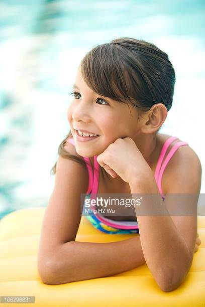 smiling-mixed-race-girl-leaning-on-pool-raft-picture-id106298831 (408×612)