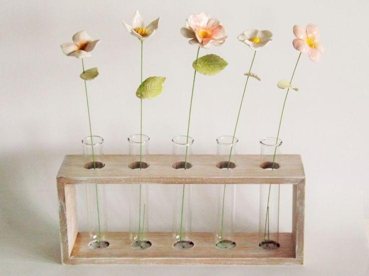 Ceramic flowers in a testube vase by Bron's Ceramics
