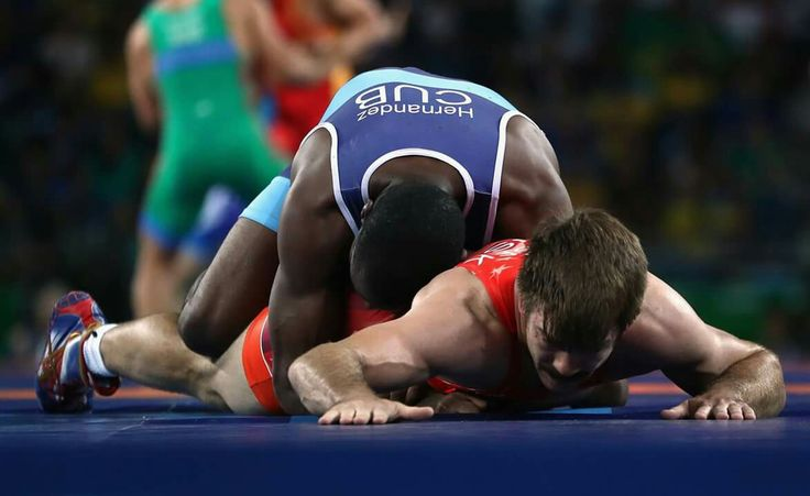 RIO DE JANEIRO, BRAZIL - AUGUST 14: Andrew Thomas Bisek of the United States (red) competes against Yurisandy Hernandez Rios of Cuba during the Men's 75 kg Greco-Roman Wrestling 1/8 Final on Day 9 of the Rio 2016 Olympic Games at the Carioca Arena 2 on August 15, 2016 in Rio de Janeiro, Brazil. (Photo by Phil Walter/Getty Images) — in Rio de Janeiro, Brazil.