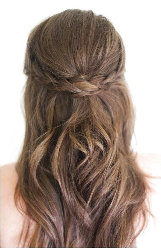 Get the polished look of an updo with the ease of wearing your hair down with these romantic half-up, half-down wedding hairstyles. #StylesForWavyHair...