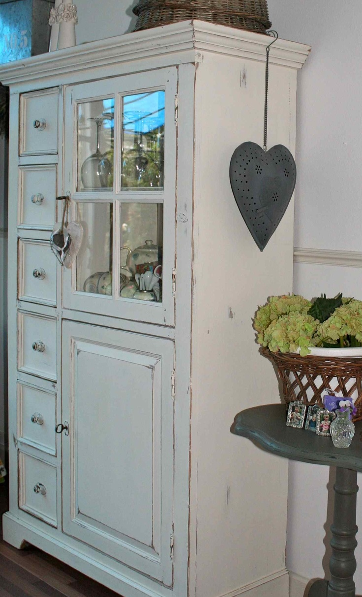 use mirrored glass on white hutch in kitchen to hide toaster on opposite side.  like drawers!