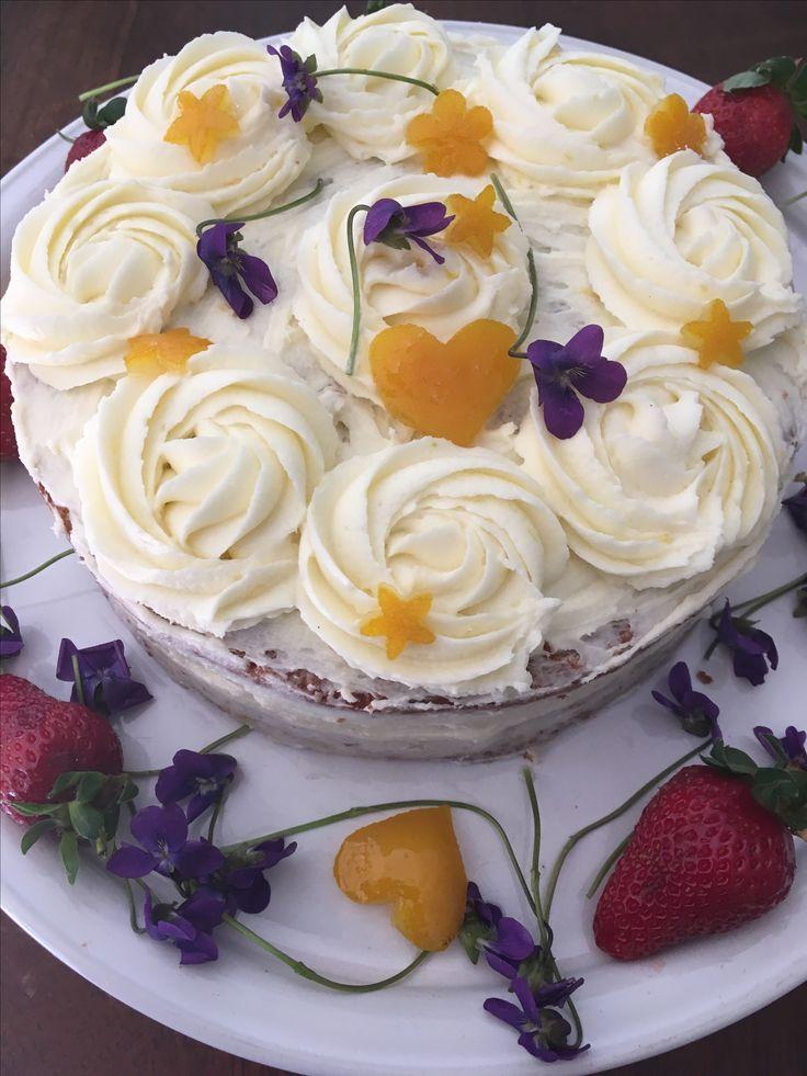 Wheatfree carrot cake with fresh orange zest and juice,fresh banana topped with lemon cream cheese icing