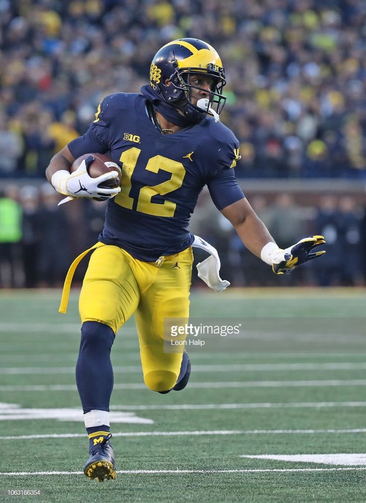 Chris Evans of the Michigan Wolverines runs for a first