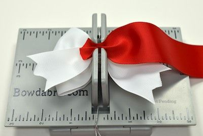I accidentally stumbled across this product and just ordered one from walmart.com. Posting for any of my crafting pals into making hair bows, or pretty package bows! Wish I'd known about this months ago.
