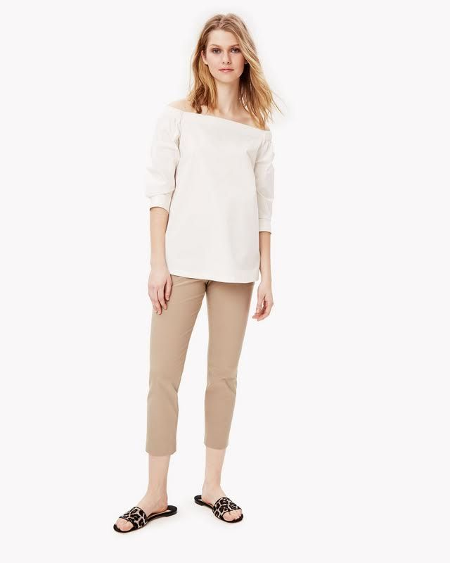 The off-the-shoulder shirt. Revisited in crisp, comfortable cotton poplin with a touch of stretch for that quintessential summery feeling. Ruched details and button cuffs add a modern, romantic flourish. Dress yours with a relaxed skirt or crop pant.