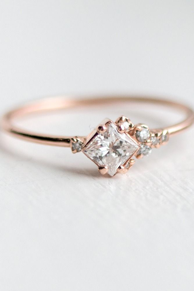 Rose Gold Engagement Ring | This asymmetrical ring design is simple, yet unique with its offset side diamonds creating a stunning diamond border around the main stone | Alternative engagement rings for every kind of style. Find yours in our engagement ring guide