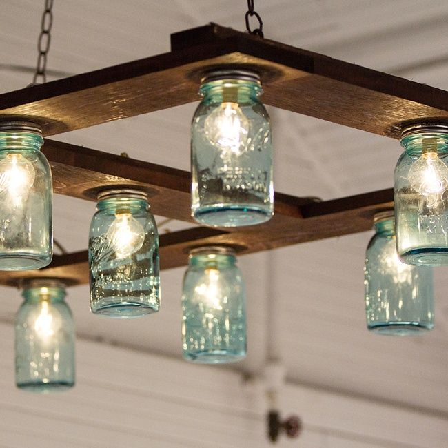 The Created Their Own Impressive Diy Light Fixture Out Of Mason Jars Cafe Lights And A Wood Palette Weddings Pinterest Jar