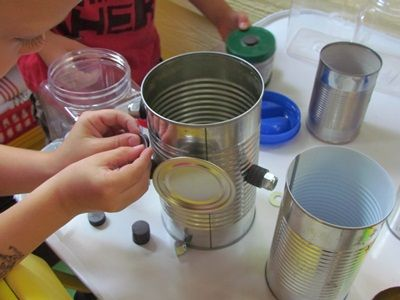 Tin Can and Magnet Discovery Table by Teach Preschool