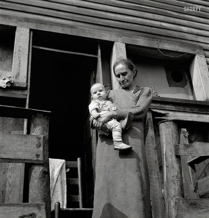 """September 1938. """"Mother-in-law of unemployed coal miner and his child. Marine, West Virginia"""