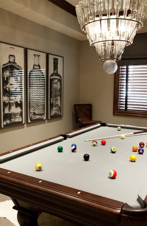Fantastic Games Room Features A Tiered Glass Bottles Chandelier, Arteriors  Stedman 5 Light Iron Glass Chandelier, Hanging Over A Pool Table.