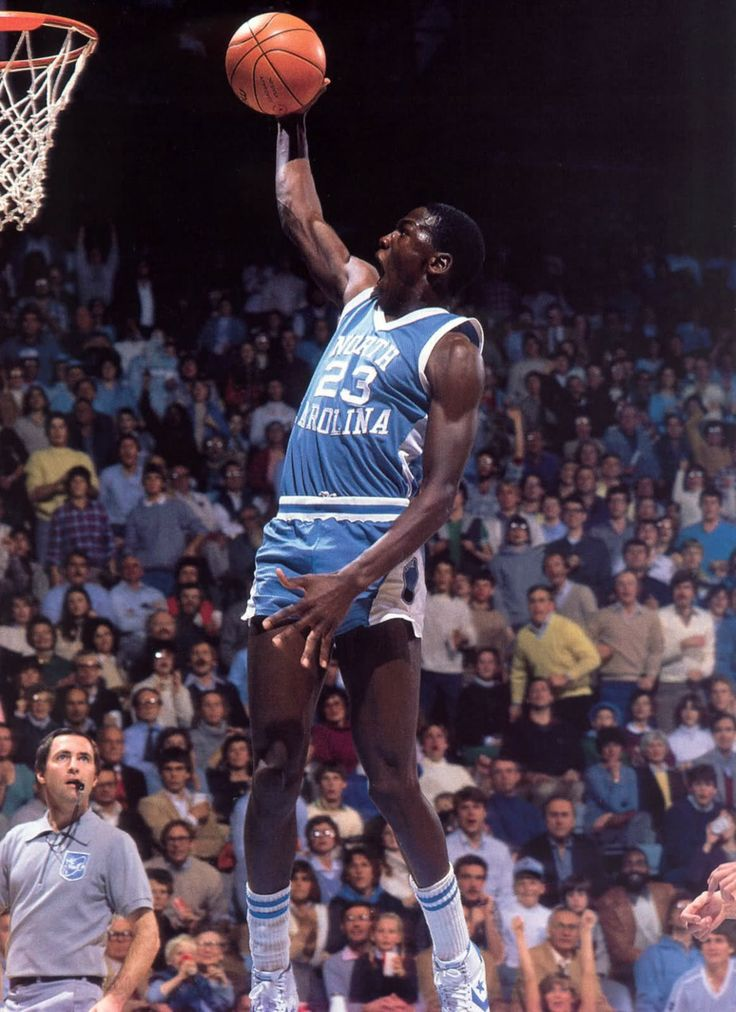 Rare, hand-signed photo featuring the autograph of the legend, Michael  Jordan, during his tenure at North Carolina. This photo reveals what Jordan  did best