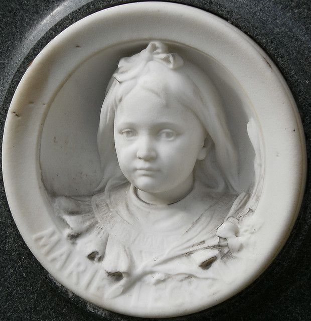 Sad, yes....but how loved little Marie was and now forever remembered.  Petite Marie, Père Lachaise cemetery, Paris