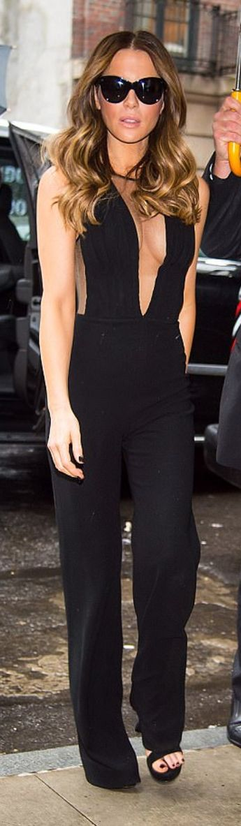 Who made  Kate Beckinsale's black mesh jumpsuit and black sunglasses?