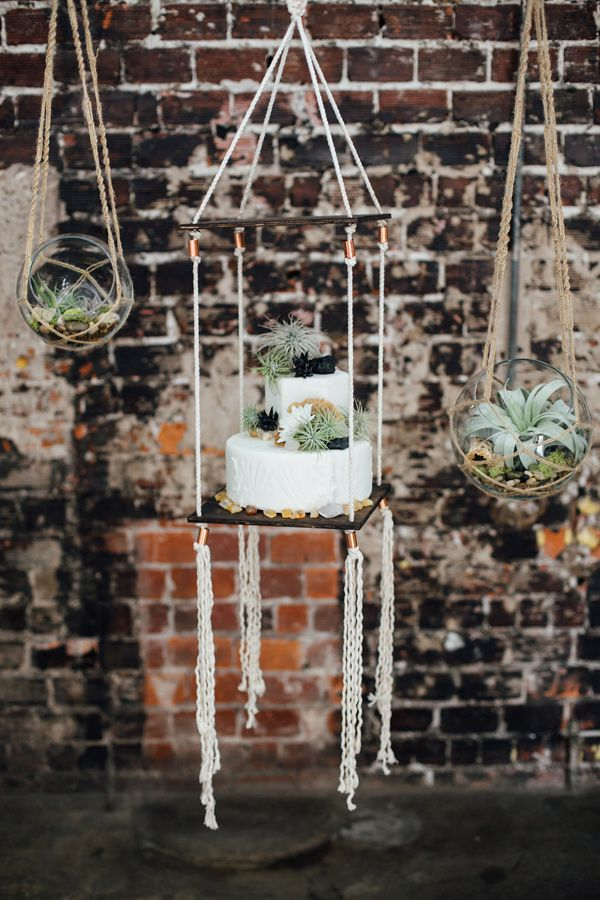 bohemian wedding cake display - photo by Monika Gauthier Photography http://ruffledblog.com/earthy-industrial-bohemian-wedding-inspiration