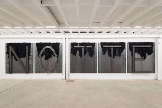 Jannis Kounellis, Senza Titolo, 2015, sheet metal, coats, beams, 200 x 900 cm. Galleria Continua Les Moulins 2015. Photo by Oak Taylor-Smith.