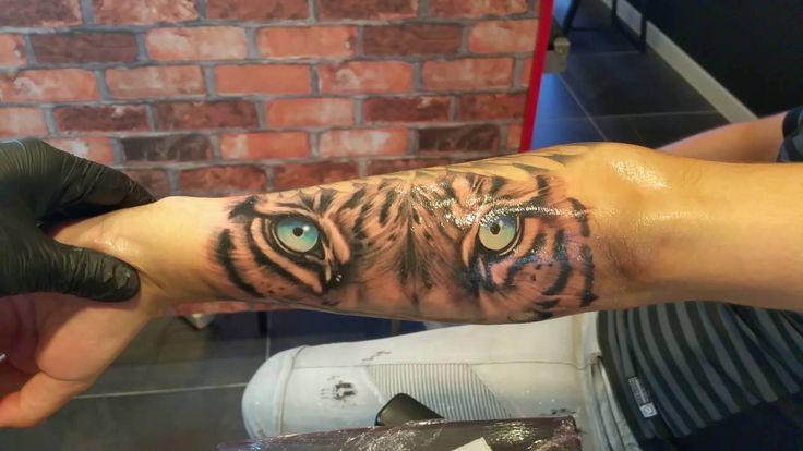 Blue Eyes Tiger Tattoo On Forearm