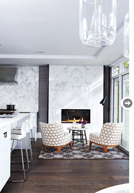 A fireplace and cozy seating in the kitchen? Yes, please! {Photography by Virginia Macdonald}