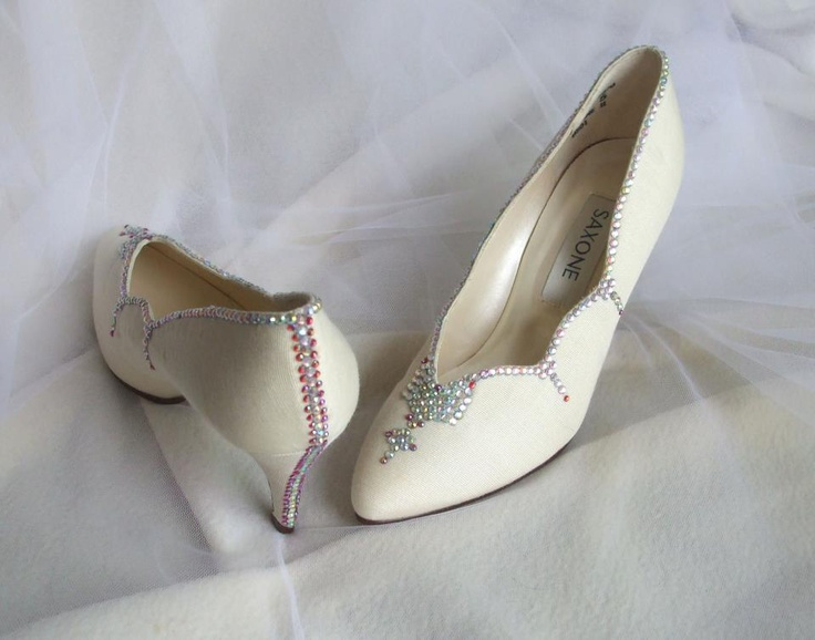 I have taken a pair of plain ivory coloured shoes and applied individual crystals in aurora and red.  Tiaraboomdeaye.co.uk
