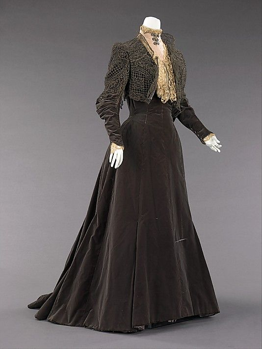 "Afternoon dress, Worth, 1889. Silk with metal trim. From the Met's page: ""Worth was credited with creating the princess line in about 1873. This shape was due to seaming from the neck, over the bust and into the skirt without interruption, as with many of the designs before it. This dress has a sense of grandeur about it in its historical reference exemplified by the sleeves and metal lace bolero evoking styles of the Medicis."""