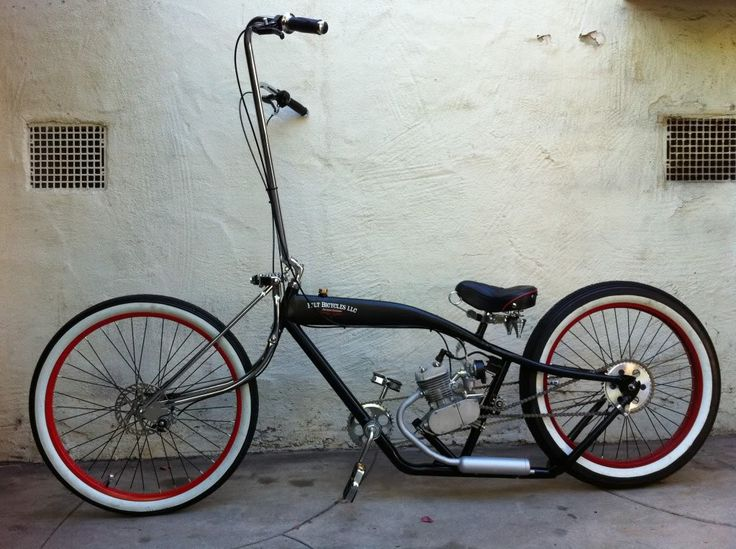 Custom lowrider bike with awesome white walls.