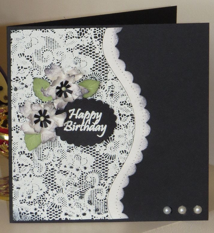 Lace stamp in ivory with handmade flowers.