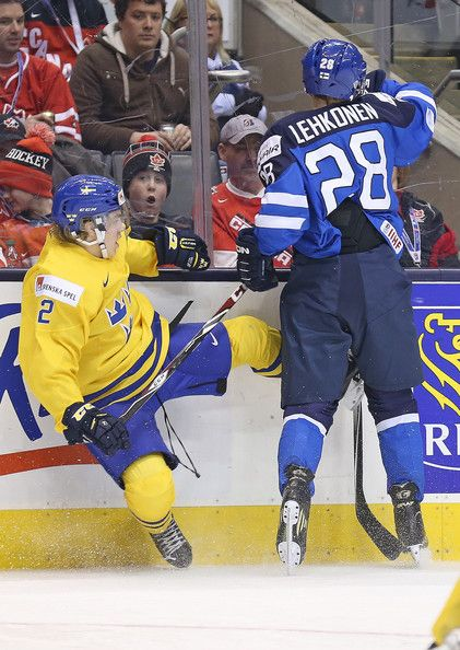 Sebastian Aho Photos Photos - TORONTO, ON -JANUARY 2:  Sebastian Aho #2 of Team Sweden gets drilled by Artturi Lehkonen #28 of Team Finland during a quarter-final game in the 2015 IIHF World Junior hockey championship at the Air Canada Centre on January 2, 2015 in Toronto, Ontario, Canada. Team Sweden defeated Team Finland 6-3. - IIHF World Junior Championship