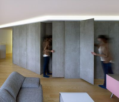 Piso Viroc by Castroferro Arquitectos Cement panels were used for storage, partitions and doors.