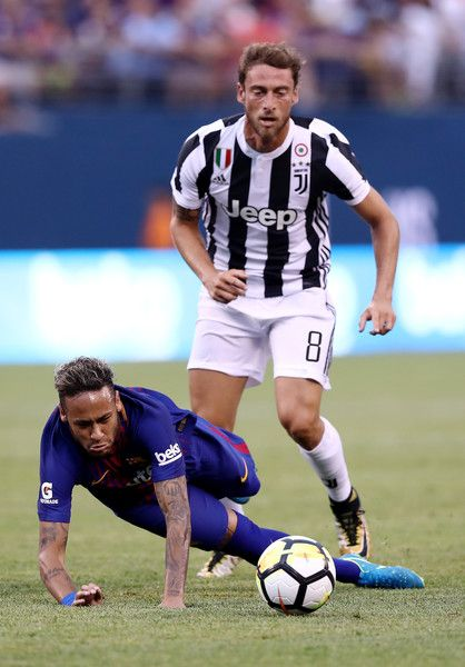 Neymar #11 of Barcelona is tripped by Claudio Marchisio #8 of Juventus in the first half during the International Champions Cup 2017  on July 22, 2017 at MetLife Stadium in East Rutherford, New Jersey.