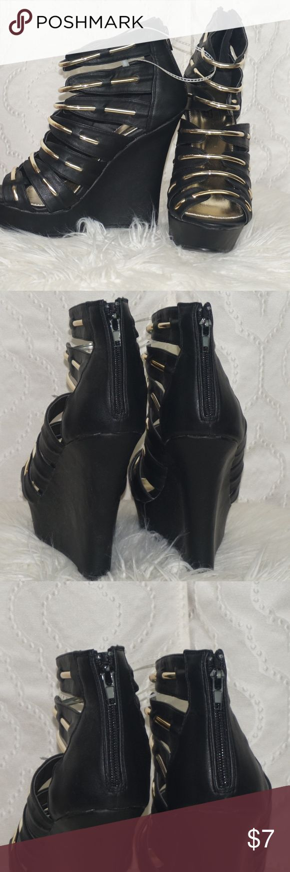 Black and Gold Wedge Heels These black and gold beautiful wedge heels have never been worn( only tried on )  They are definitely a showstopper! Shoes Wedges