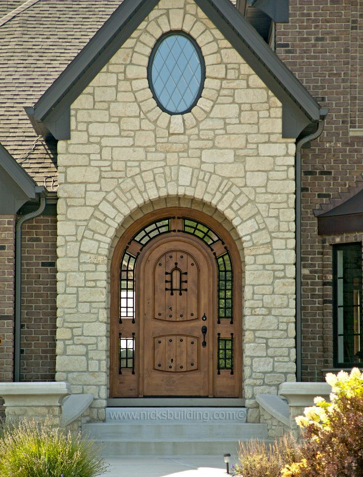 Round top front door in a natural stain color on knotty for Natural wood front door