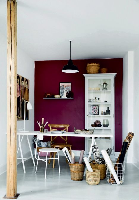 Home office with a purple wall.