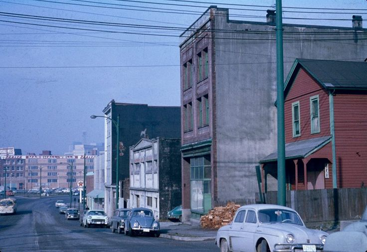 N. 100 block of Keefer St., Chinatown, photo taken around 1960. The three-story building next to the red house currently houses the Keefer Bar.