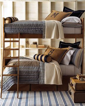 """The colors and fabrics used to create the """"Wilton"""" line of bed linens would be perfect for a boys or young man's room. The style and design is handsome and classic. Tailored panel dust skirts in khaki have an 18"""" drop. Khaki standard sham can be monogrammed with a single initial in style and color shown."""