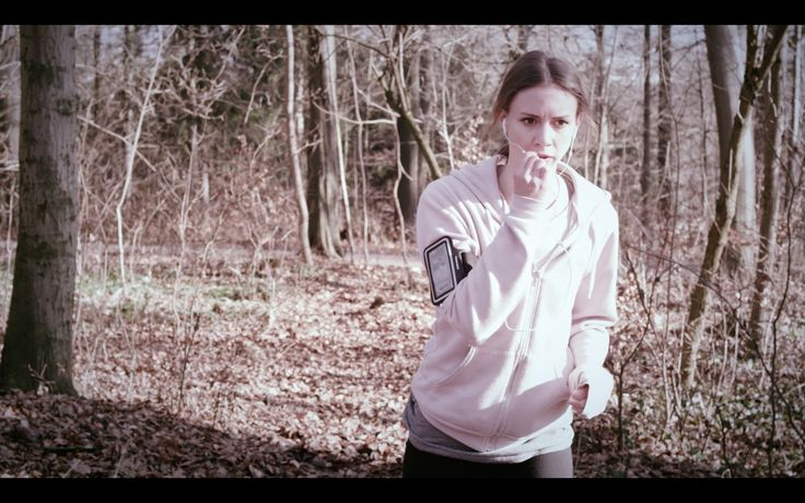 """Our actress Lilli in action! """"Select laser gun!"""" Soon that might be you, going (r)undercover in your nearby running track! (Still from our Kickstarter video)"""