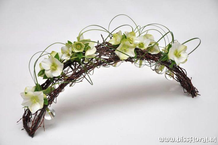 Winter flower arrangement - Arch frame with Helleborus