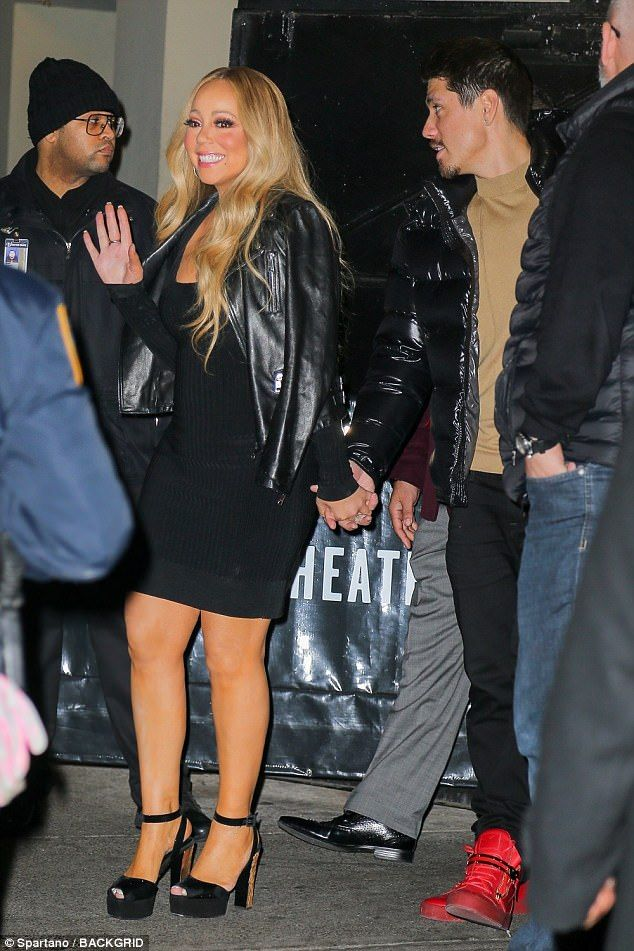 Plenty of support: Mariah, who wore towering chunky black heels, was accompanied by her backup dancer and boyfriend Bryan Tanaka along with her security detail