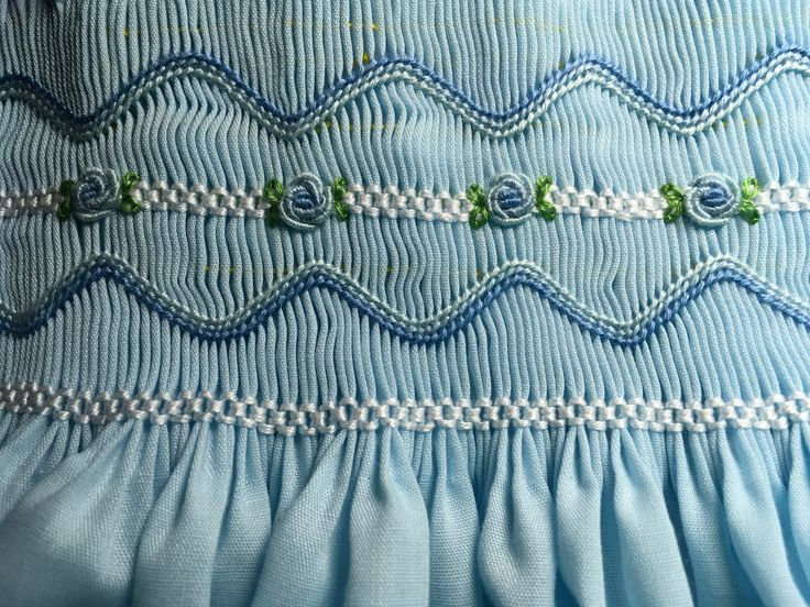 Smocked by Sandy Keys. I couldn't make up my mind whether to embroider the bullion roses in pink or blue. I think that I like the blue
