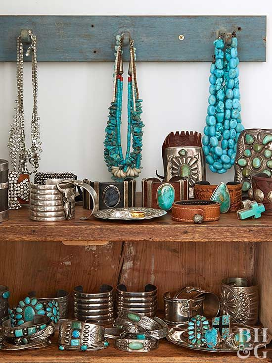 Turquoise and teal are staple shades of Southwestern jewelry. Instead of hiding it away, display your wares proudly with this stunning shelving idea. A rustic piece of furniture is perfect for housing watches, bracelets, and other bulky items. Necklaces and more delicate pieces hang from a blue reclaimed-wood rack.