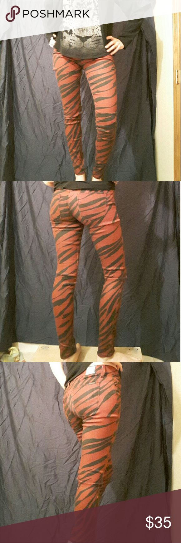 """Red and black Hudson skinny jeans How bad@$$ are these?! Seriously rocking red and black skinny Hudson jeans. These pants are a size 26 and they fit like a size 4. Inseam is 29"""". Any questions, just ask. Bundle and save! Hudson Jeans Pants"""