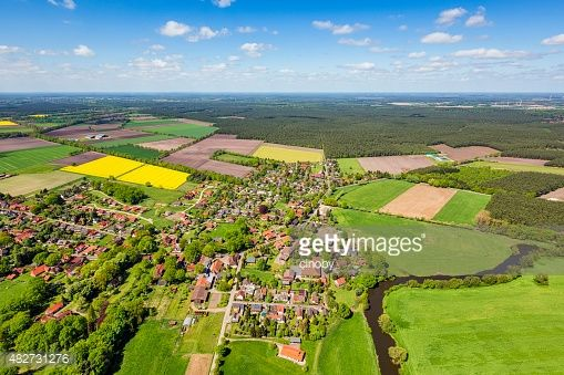 Aerial view of a suburban area and agricultural land in Germany.Small village is suburb from Celle, in Lower Saxony, Germany.