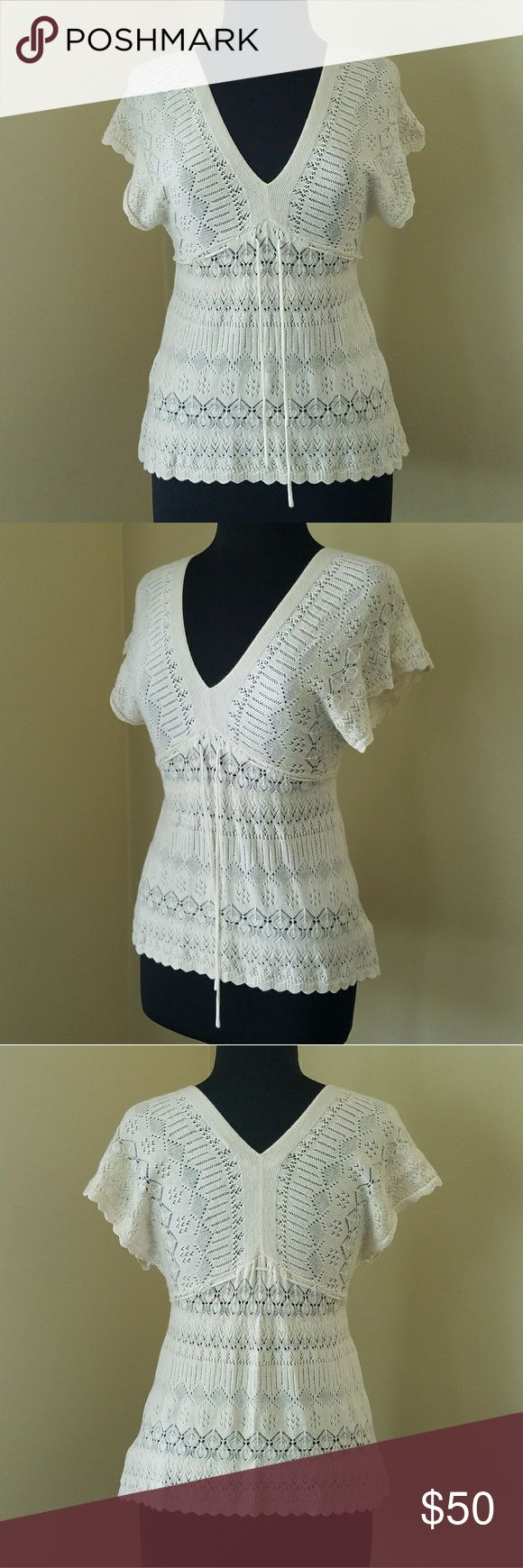 Anthropologie, XS, Knitted & Knotted Blouse Like New! Flawless condition.  Light weight knit top with beautiful detail. Cream on color with batwing sleeves and pullstring at waist.  Size XS by Knitted & Knotted from Anthropologie. Anthropologie Tops Blouses