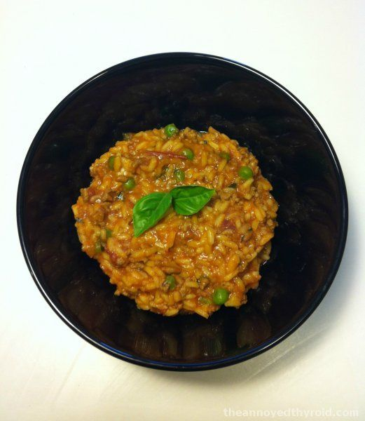 Thermomix Beef Risotto 60g parmesan cheese 1 clove of garlic 1 onion, quartered 90g butter or margarine 100g tomato paste or pizza sauce 400g tin tomatoes, diced 70g (or 1-2 tbsp) vegetable stock paste 500g beef mince 300ml water 200g (1 cup) long grain rice 1 cup frozen peas 1/2 bunch of basil