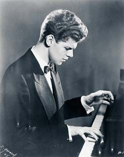 "Harvey Lavan ""Van"" Cliburn, Jr., (1934–2013) American pianist who achieved worldwide recognition in 1958 at the age of 23, when he won the first quadrennial International Tchaikovsky Piano Competition in Moscow at the height of the Cold War. In 1998, Cliburn was named in a lawsuit by his domestic partner of 17 years, Thomas Zaremba. In the suit, Zaremba claimed entitlement to a portion of Cliburn's income & assets & went on to charge that he might have been exposed to HIV"